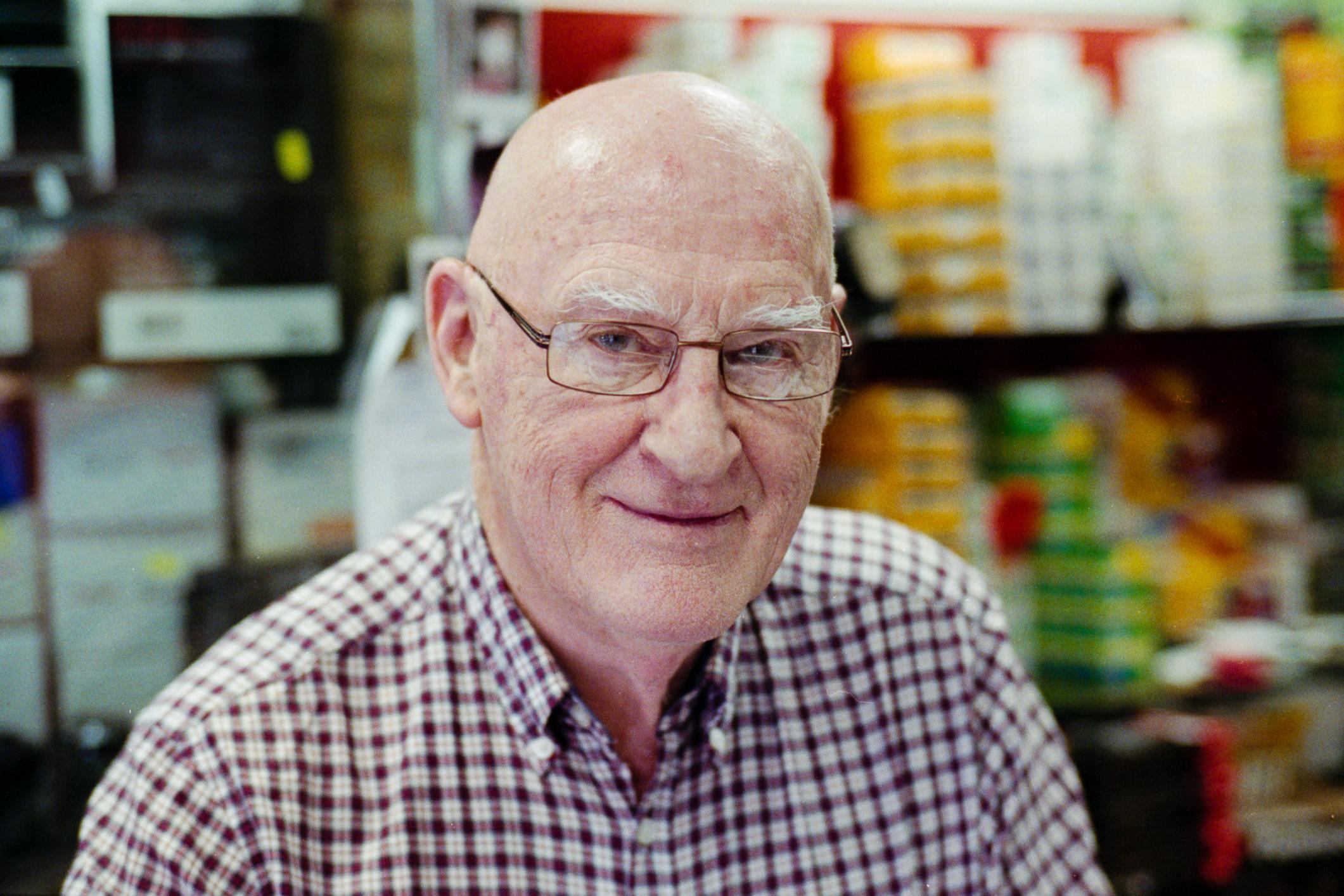 Mr John Gunn from John Gunn Camera Shop (Dublin 2015), Leica M2, Zeiss C Sonnar 50mm f/1.5 @ f/2, Fuji Xtra 800, Epson V700